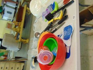 various plastic bowls  kitchen utensils  and glass