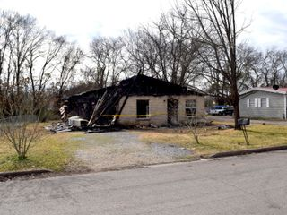 SELLING ABSOLUTE! ONLINE AUCTION featuring Fire Damaged Home - Must Be Torn Down - Previously 4 Bedroom, 1 & 1/2 Bath Home with Carport