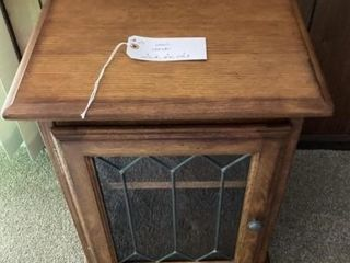 Small wooden cabinet with rounded corners and legs