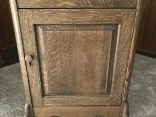 Small wooden cabinet with glass front