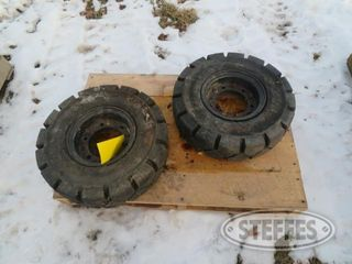 2 New forklift tires 1 jpg