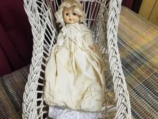 Wicker bassinet rocker with vintage doll