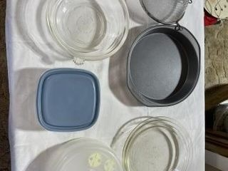 Glass dish  pie pans  plastic bowls and misc