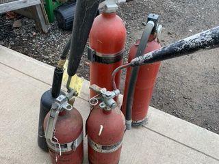 4 lARGE FIRE EXTINGUISHERS