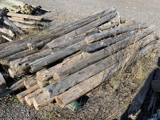 SKID OF WOODEN CEDAR POSTS MOST ARE 8FT lONG