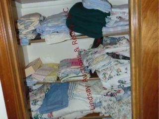 CONTENTS of closet  sheats  pillow cases  towels