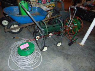2 garden hoses   2 hose reels
