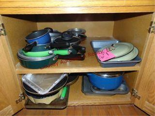 CONTENTS of cabinet  pots  pans  bakeware
