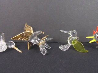 4 assorted glass bird figurines