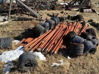Rolls of Barbed Wire   T Posts