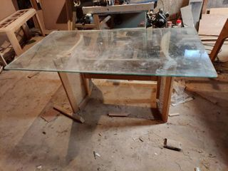 Glass Top   Wicker Base Table   Glass Needs Cleaned   Basement