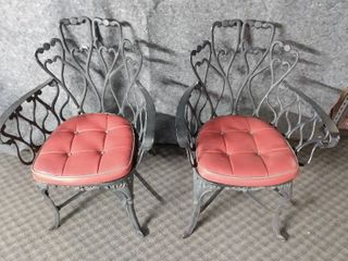 pair of cast chairs with cushions
