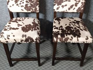two replica cowhide tall chairs