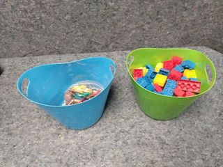 small tub of big lego blocks and small tub with small bag of plastic animals