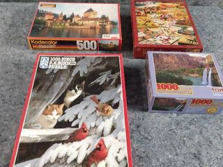 four boxes of puzzles