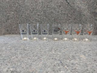 one pint glasses with sport teams on them