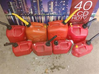 lot of 8 Gasoline Canisters