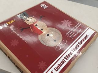 4  lighted silver tinsel Snowman