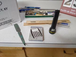 Box of Pens Pencils  Flashlight  letter Opener