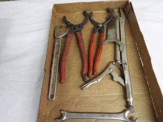 lot with 2  oil filter pliers  long neck vise grips and a wrench