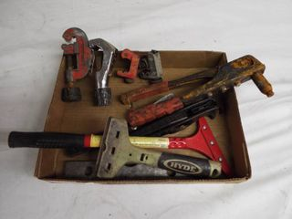 lot of pipe cutters and scrapers