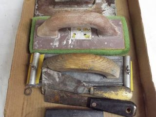 lot of hand sanders and putty knifes