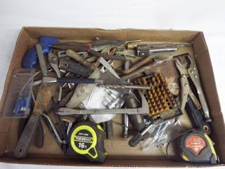 lot with tape measure  putty knifes  vise grips  saw handle and more
