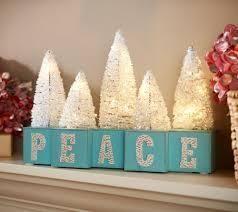 Inspirational Message Blocks with lit Bottle Brush Trees by Valerie  Joy