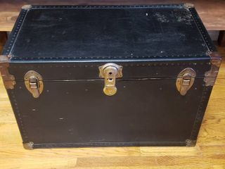 Black Streamer Trunk w leather Handles  one broken  and Interior Shelf   no key   33 x 19 x 21 in  tall