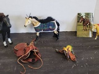 2 Plastic Horses  1 Rubber Horse and 2 Toy Saddles  one is leather