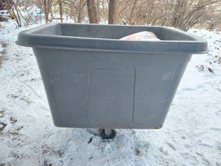 Rubbermaid Trash Cart  1 Mis sized Wheel  and Contents