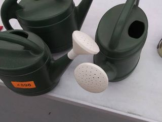 3 watering cans