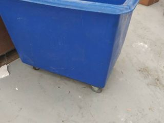 blue rolling tub  could be used for trash  used and dirty
