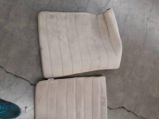 2 beige carpets