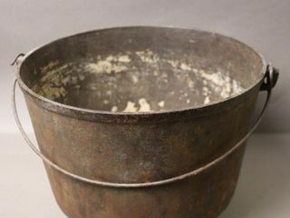 THREE FOOTED CAST POT WITH HANDlE 10X11X9