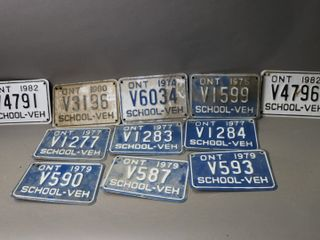 lOT OF 11 SCHOOl VEHIClE lICENCE PlATES