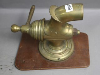BRASS TAP MOUNTED ON WOOD 9