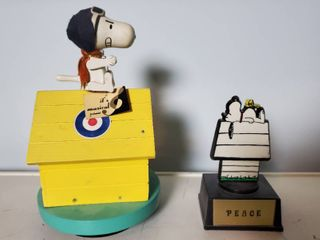 lot of 2 Snoopy Collectibles  1 Schmid Carousel Music Dog House   1 Peace Figurine