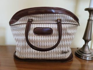 Neiman Marcus leather and Diamond Canvas Carry On