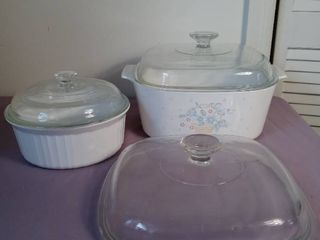 lot of 2 Deep Glass Casserole Dishes with lids and an Extra lid   Bigger Dish is Corning Ware and lid on Smaller Dish is Chipped