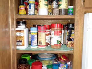 Contents of Cabinet   Various Spices Some Expired Some Not