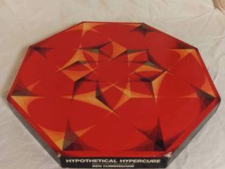 Hypothetical Hypercube Painted Especially for Springbook Editions by Ben Cunningham The OTKA Puzzle