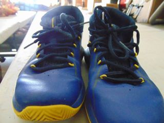 Pair of Youth Size 5 Under Armour Basketball shoes