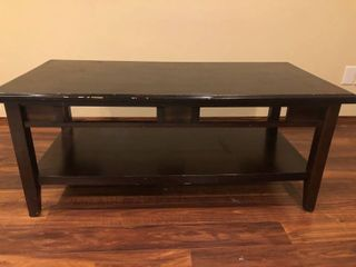 Brown coffee table 22x47 minor damage