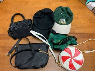 Three purses  a fanny pack and two hats