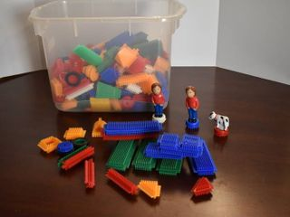 Plastic Tub Full of Children s Connecting Toy Pieces