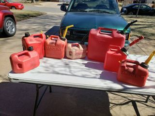lot of 7 Assorted Plastic Gas Cans