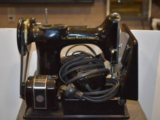 Vintage Singer Featherweight Sewing Machine   Includes Carrying Case  12 Colors of Thread  Assorted Attachments    Manual