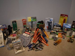 large lot of Home Repair Supplies   Includes Box Cutters  Battery Tester  Assorted Small Nails Screws    More