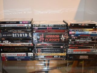 large lot of Assorted War  Crime   Horror Movies Shows On DVD   Titles Include   The Road  The Skeleton Key  House on Haunted Hill    More